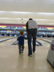 Asher bowling with Daddy